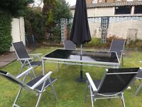 Fantastic black and silver table 6 chairs and umbrella