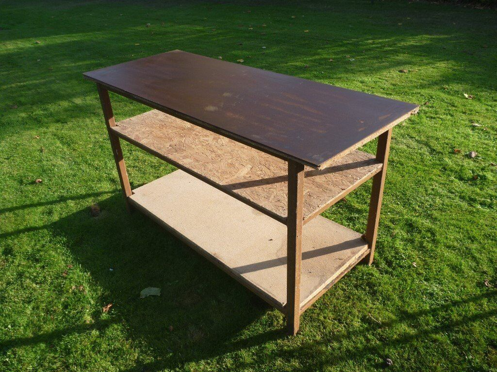 Sturdy Workshop Bench with plate steel top, and tool shelves.