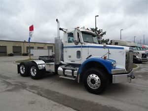 2010 Freightliner FLD12064SD Heavy Spec Day Cab with Engine Rebu