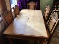 Large rustic / chunky farmhouse carved wood dining table and 6 gothic style chairs