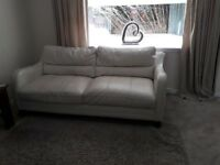 2 x 3 Cream Leather Seater Sofas in reasonable condition - suitable for starting out