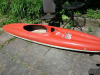 Vintage virtually uncapsizebale kayak