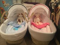 2 Moses baskets with rocking stands (blue and pink)