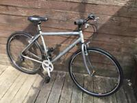 Adult aluminium Raleigh hybrid bike with 19 inch frame and 21 gears