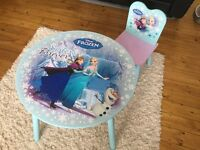 """""""Frozen"""" table and two chairs"""