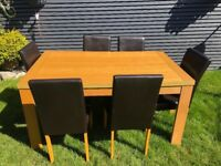 Dining table and 6 leathers chairs