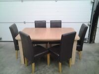 Ex display Extendable dining table and 6 chairs in choc brown faux. All very good Can deliver.