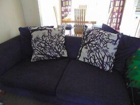 Lovely 3 seater purple sofa