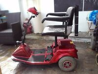 Red 3 wheeled Handicare Calypso Mobility Scooteer