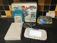 Nintendo wii u white with 4 games incl Super Mario Maker