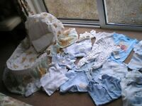 New born baby boy clothes plus a moses basket.