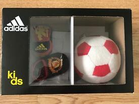 MUFC Baby slippers and soft ball.