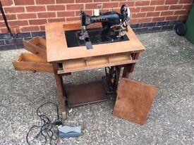 Antique sewing machine original receipt and bits. 1937
