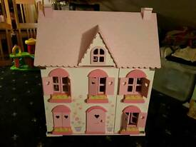 Fantastic wooden dolls house with furniture and characters