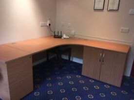 Desk with filing cabinet and storage cupboard
