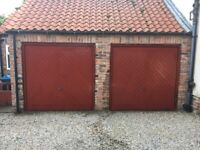 Two chevron pattern wood effect up-and-over garage doors