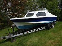 Shetland 535 motor boat with trailer.