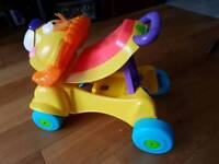Baby walker plus a ride on Fisher Price Lion
