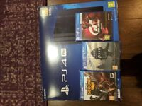 PS4 Pro Boxed + 3 Unopened Games