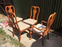 4 SOLID WOOD DINING CHAIRS.