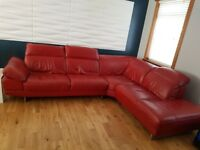 Red leather corner sofa.