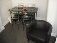 black glass dinning table with four chairs for sale