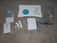 nintendo wii and wii fit board + games