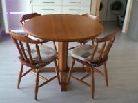 Round solid cherry wood kitchen table and chairs.