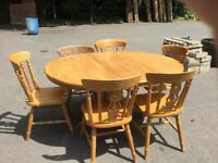 Wooden table & 6 chairs ( easy extended from 4 place round to 6 place oval table