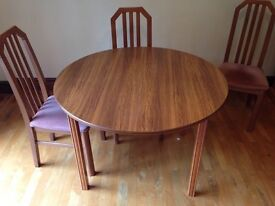 Extendable Dining Table (Round or Oval) with 4 Chairs