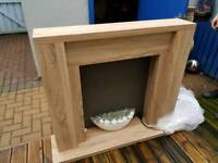 NEXT Light Oak effect wooden fireplace with integrated electric fire