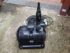 Used pond pump in good working order approx. under 2000 litres per hour.