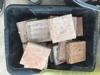 Square red Victorian tiles. Used to make up kitchen floor. 10cm x 10cm