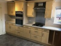 Kitchen complete with electric oven and gas hob, worktop and sink