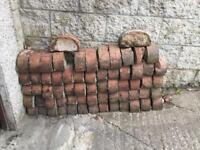 Half round reclaimed red coping, edging bricks, 65 in total ,