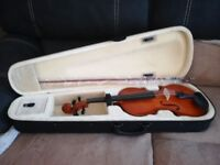 Full size violin with bow and case.