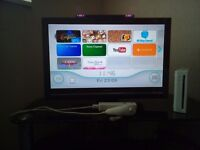 Wii console with 3 games