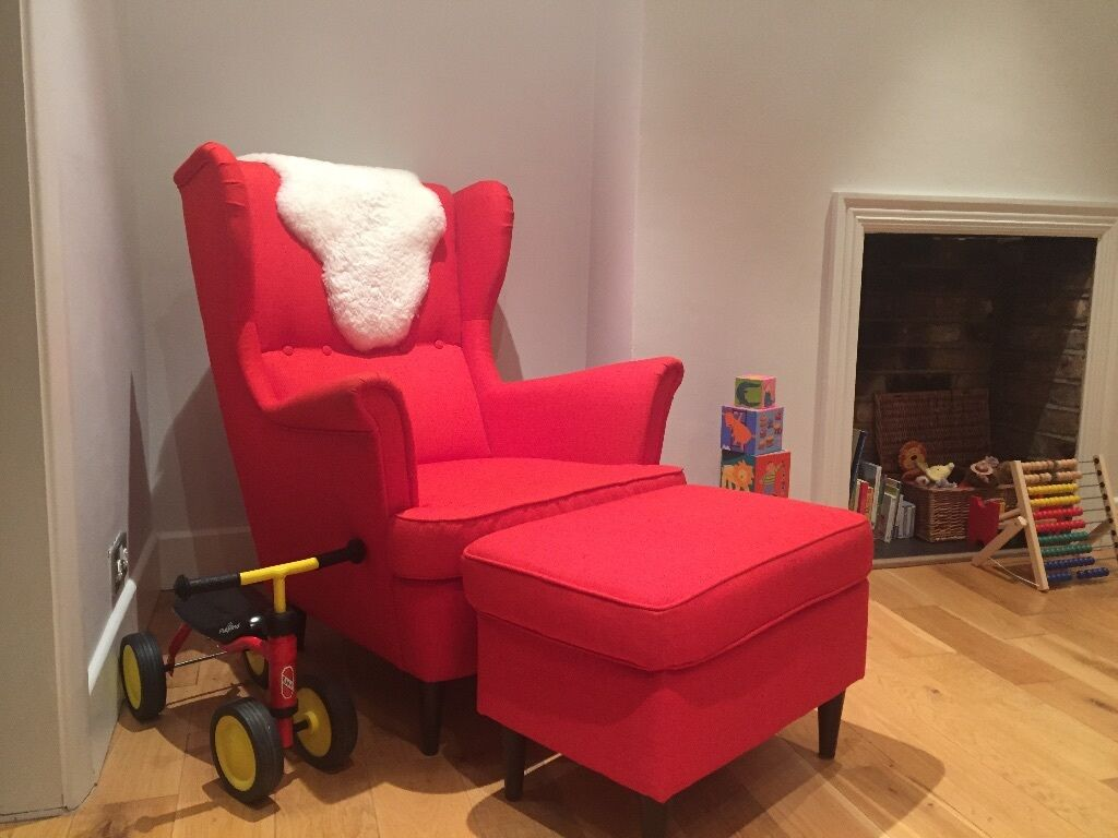 ikea wing chair and footstool strandmon  orange