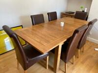 Wood and leather extendible dining table and six chairs