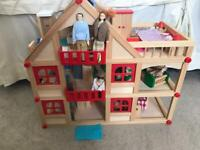 Lovely wooden dolls house, furniture and family.