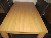 modern light oak table with 6 high back brown chairs