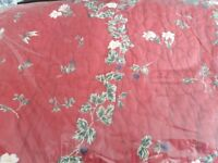 Red, floral quilt for double bed