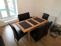 Oak extendable dining room table and chairs