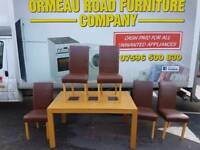 Light oak table and 5 brown leather chairs