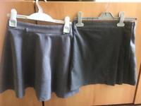 2 girls grey school skirts age 8/9