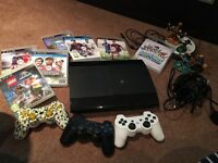 PlayStation 3 with 3 controllers and various games