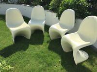 Four Panton style chairs.