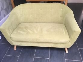 Nearly new, contempory sofa in lime green. Width 130, depth 74, seat height 44, seat depth 50.