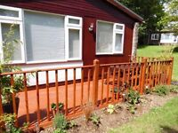 2 bed holiday Chalet in Cornwall/Devon border,sleeps 5 allows dogs set in manor House Grounds
