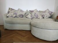 Large, comfortable sofa with separate extended leg rest and separate cushions